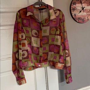 Women's Mesmerize sheer button-down blouse.